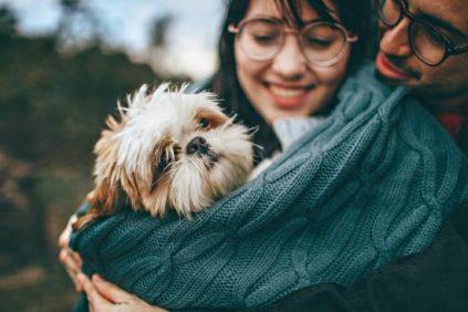 Couple hugging deaf dog