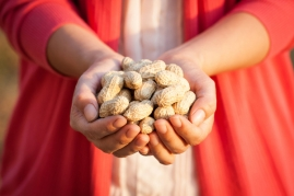 hands with peanuts