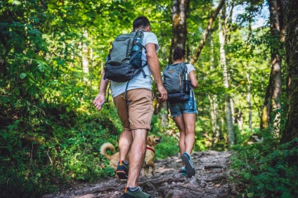couple hiking with dog