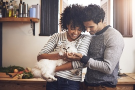couple holding a cat