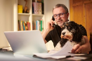 Man budgeting with dog