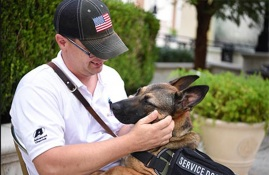 A soldier and his service dog