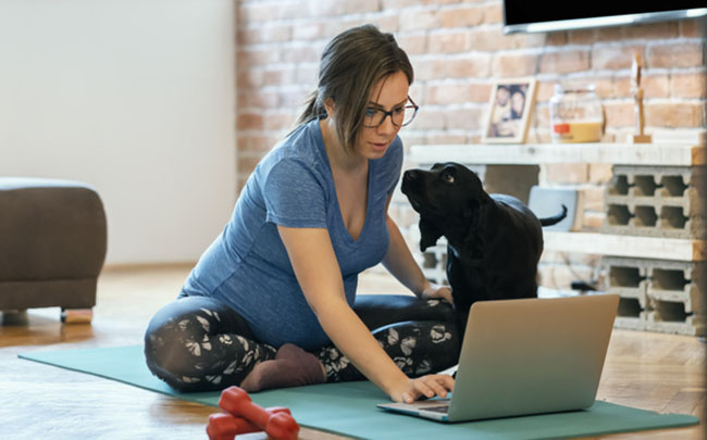 Woman online training with dog