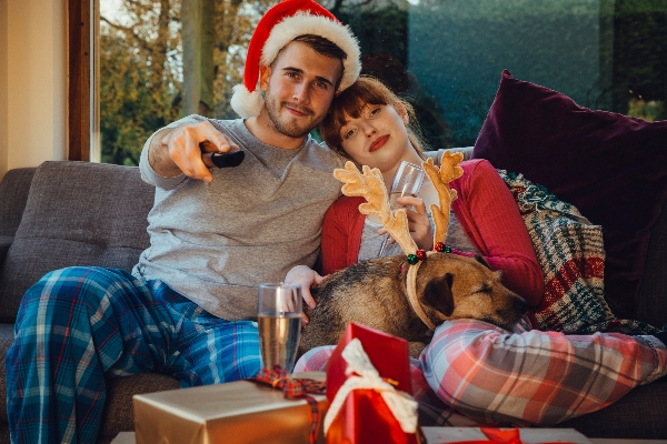 holiday couple and dog watching TV
