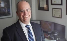 Dr. Adam Stern, an associate professor of forensic pathology