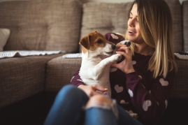 woman holding terrier puppy