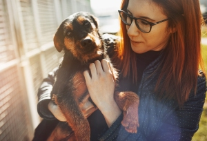 Woman with dog she is fostering