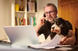 Man budgeting with dog