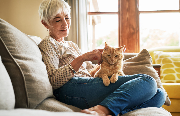 Older person with a cat